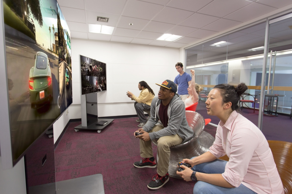 Students playing video games in the game space