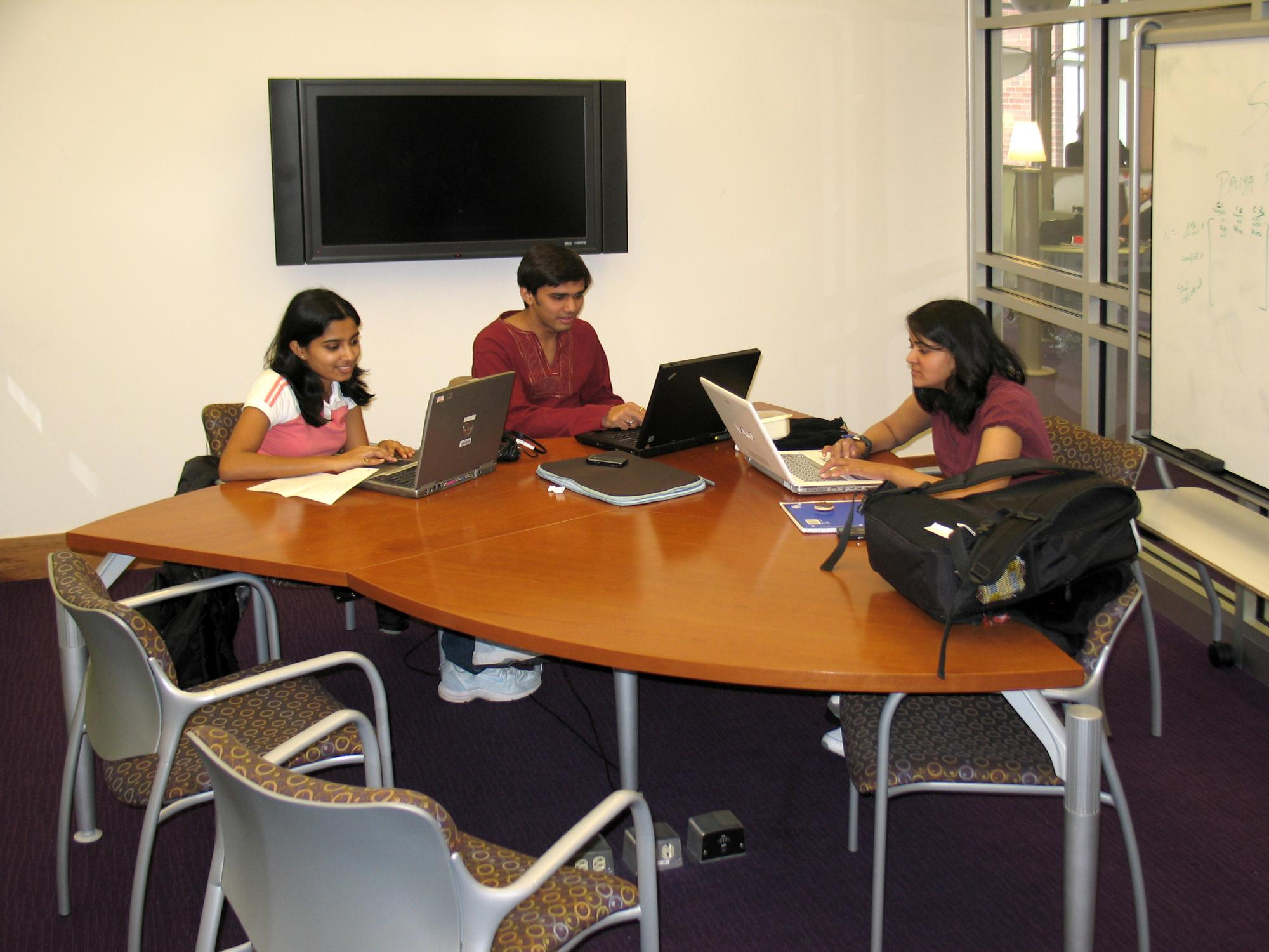 Students using a Learning Commons study room