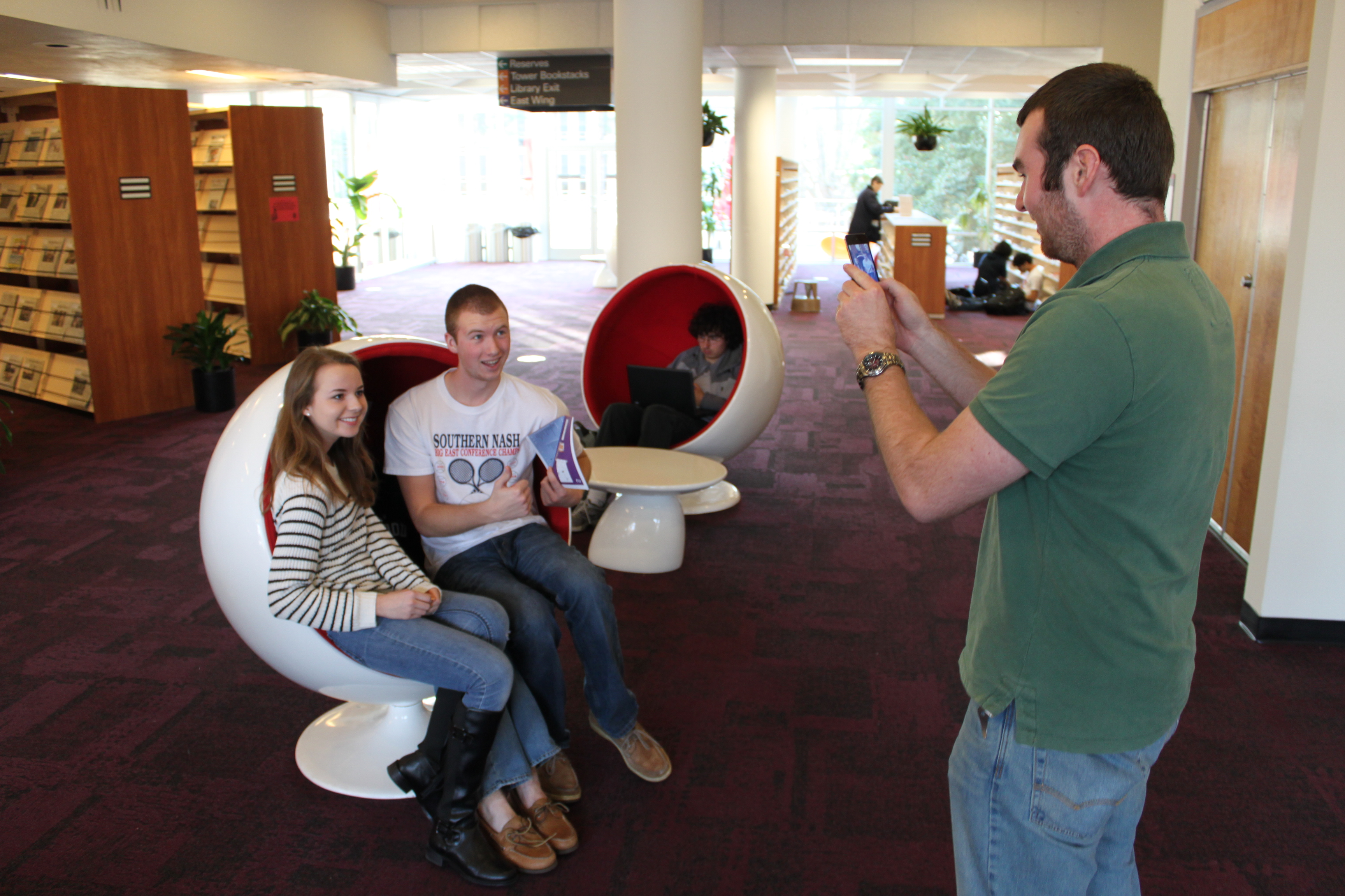 NCSU students taking a photo in the ball chairs during a scavenger hunt.