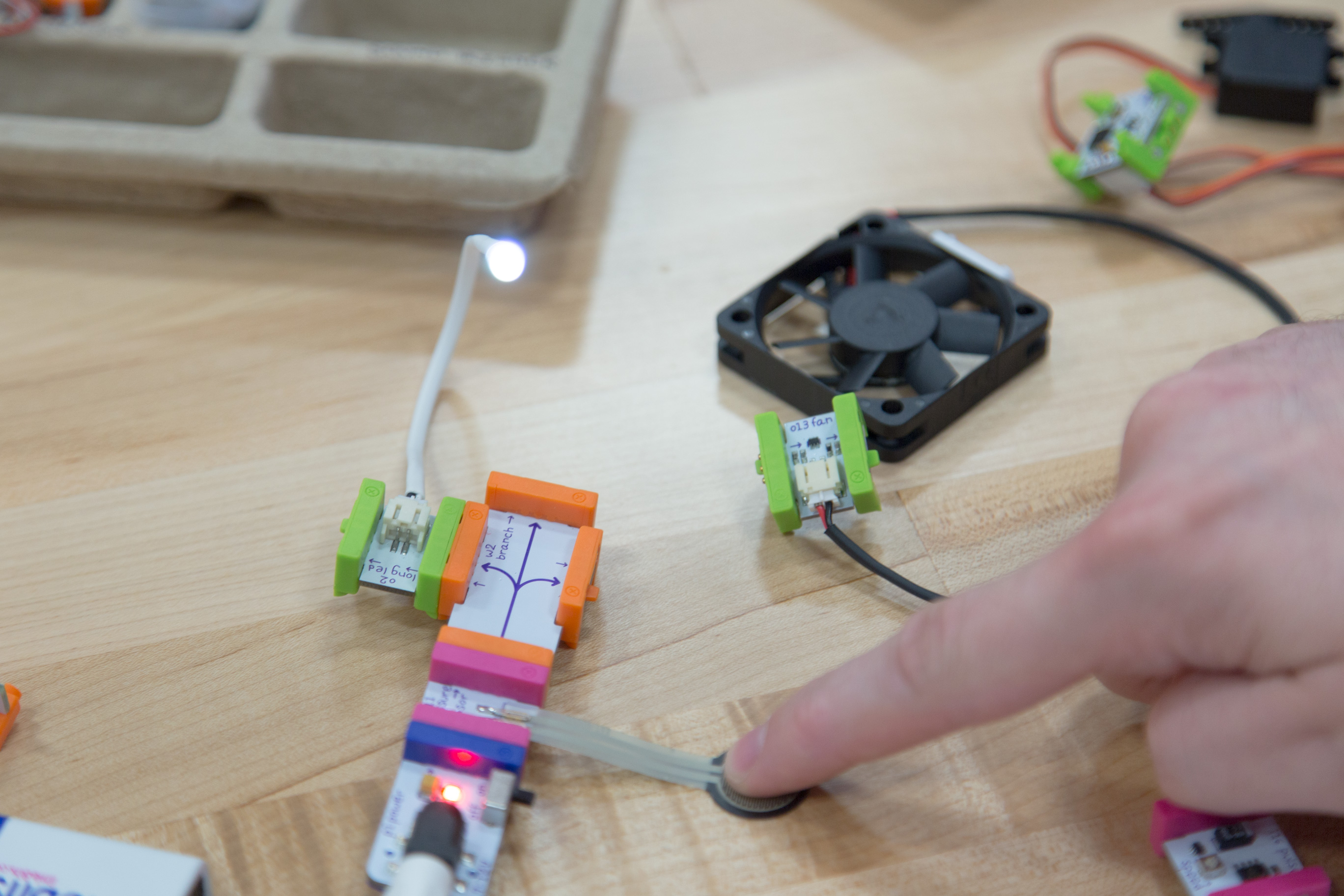 A student tests a circuit and explores modes of interactivity.