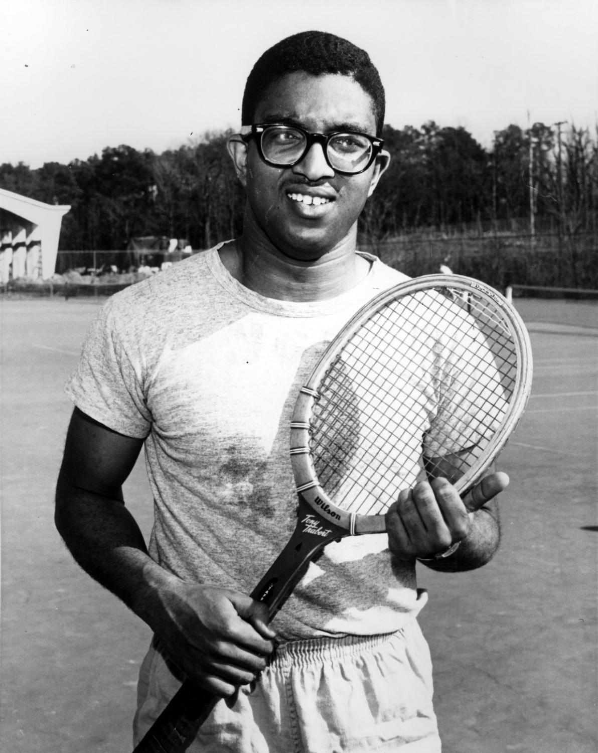 Irwin Holmes on NC State tennis court, 1957.