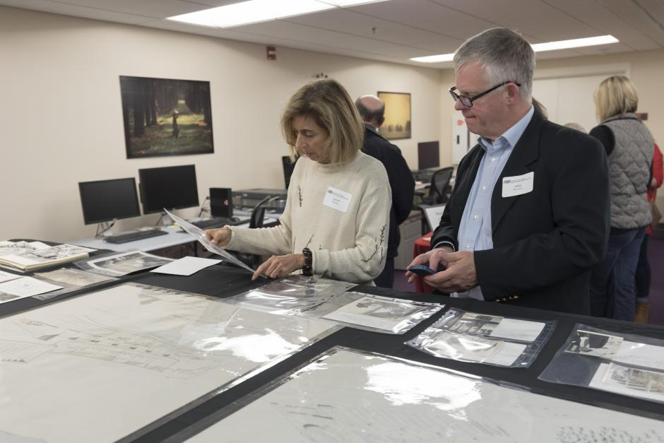 Guests browse sketches of the NC State Fairgrounds and photographs of the Dorton Arena under construction.