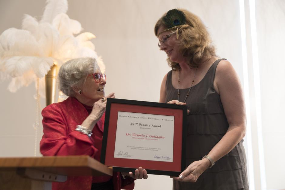 Susan Nutter presenting the 2017 Libraries Faculty Award to Dr. Victoria J. Gallagher