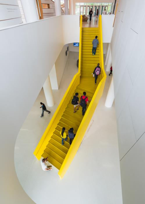 Patrons ascending staircase to the second floor of the Hunt Library