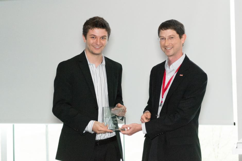 Director of Visualization Services Mike Nutt presents Anthony Smith with his award at the Code+Art awards ceremony.