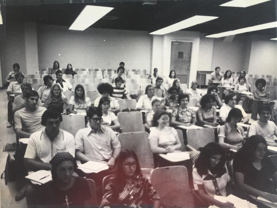 Justina Williams, seated in far right of frame, attends a class at NC State.