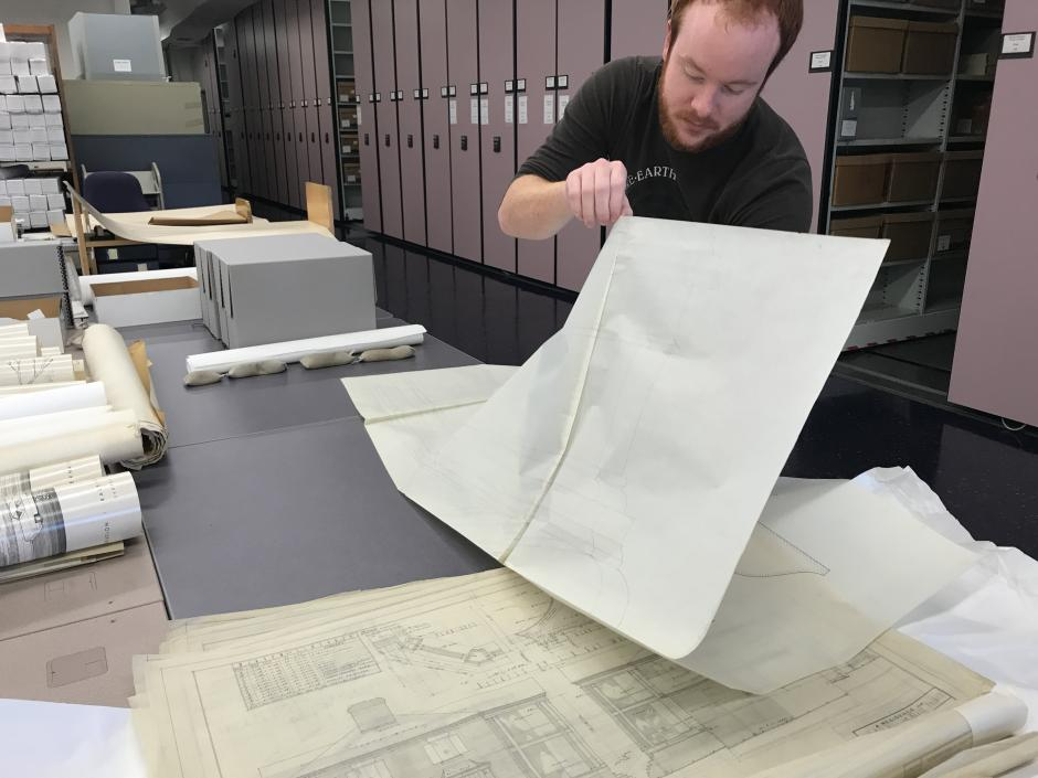 Graduate student processing an architectural collection