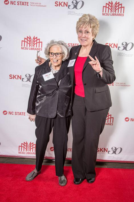 Susan and NC State Athletic Director Debbie Yow pose on the red carpet at the Museum of Art party for Susan in June.