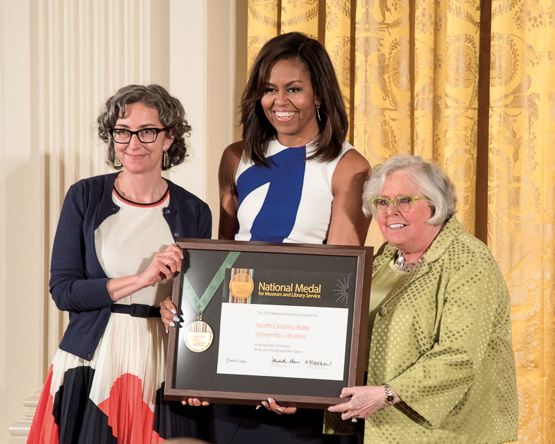 First Lady Michelle Obama presents the IMLS Medal to Susan K. Nutter and Marsha Gordon