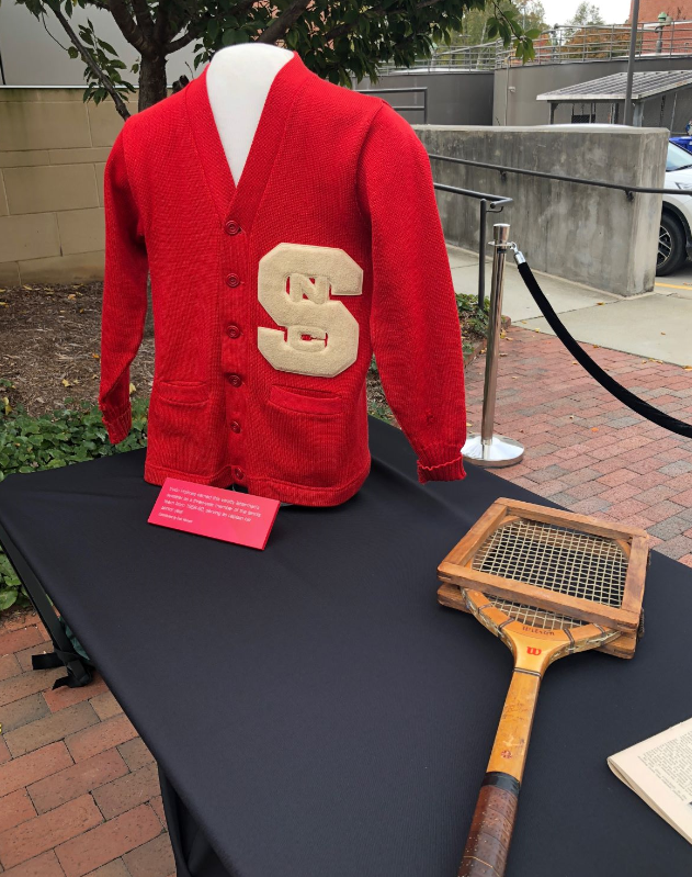 Irwin Holmes's varsity letter jacket and tennis racket on display at Holmes Hall dedication ceremony, November 1, 2018.