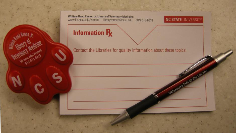 Display of information prescription pad, paw clip, and pen with Library contact information