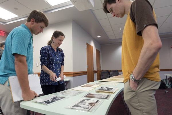 SCRC Associate Head and Curator Gwynn Thayer talks with students about Bill Baron's Tallywood design photo