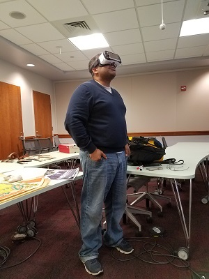 Kofi Boone uses the Oculus Gear VR to view a 360-degree image of the current Talley Student Union landscape photo