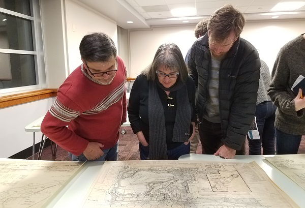 Students examine Bell's 1975 grading plan for the Student Center Plaza photo
