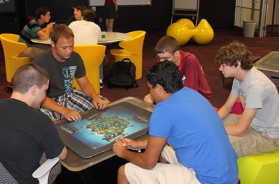students at playing a game on a Microsoft Surface