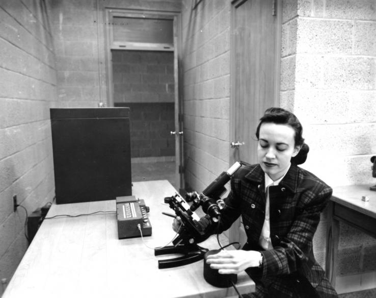 Frances M. Richardson with a microscope.