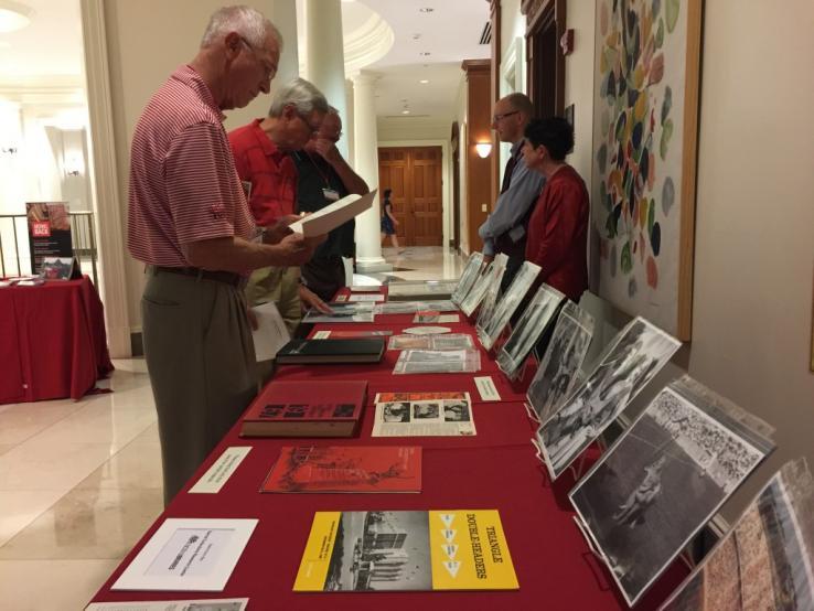 Alumni browse materials on display.