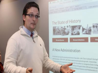 History graduate student presenting his NC State history project