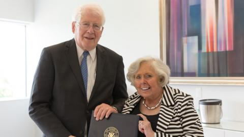 U.S. Representative David Price presents Vice Provost & Director of Libraries Susan Nutter with a signed copy of the June 10, 2016 Congressional Record.