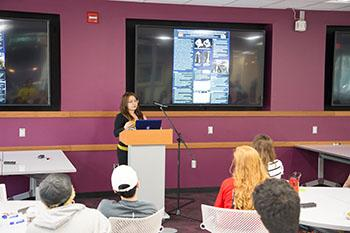Photo of an undergraduate student, presenting.