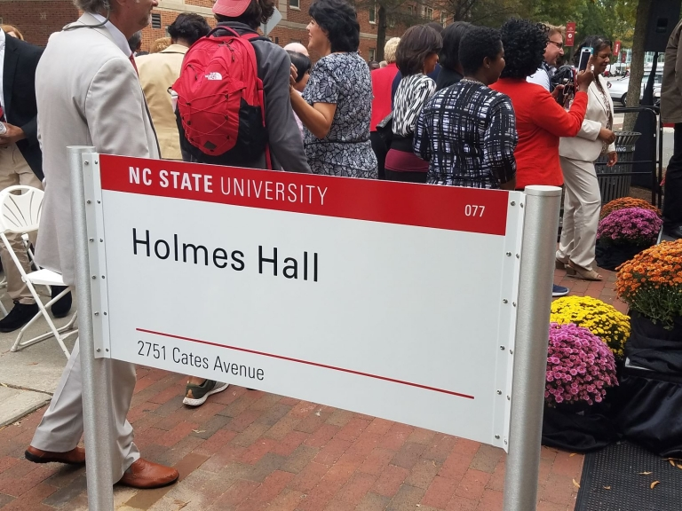 New sign for Holmes Hall unveiled at dedication ceremony, November 1, 2018.
