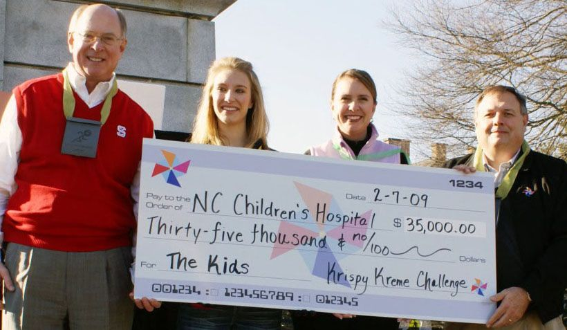 Chancellor Oblinger and others presenting an over-sized check for the NC Children's Hospital at the 2009 Krispy Kreme Challenge