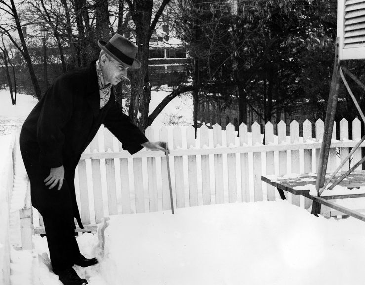 Clarence Lamoureux measures snow in Raleigh in February 1948