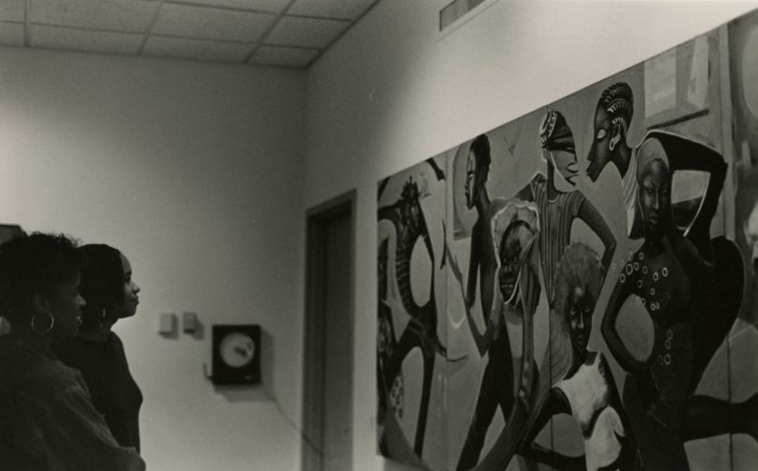 NC State's African American Cultural Center (AACC) celebrates 50 years in 2020.  Here, students view a Chandra Cox painting in the AACC gallery, 1994.
