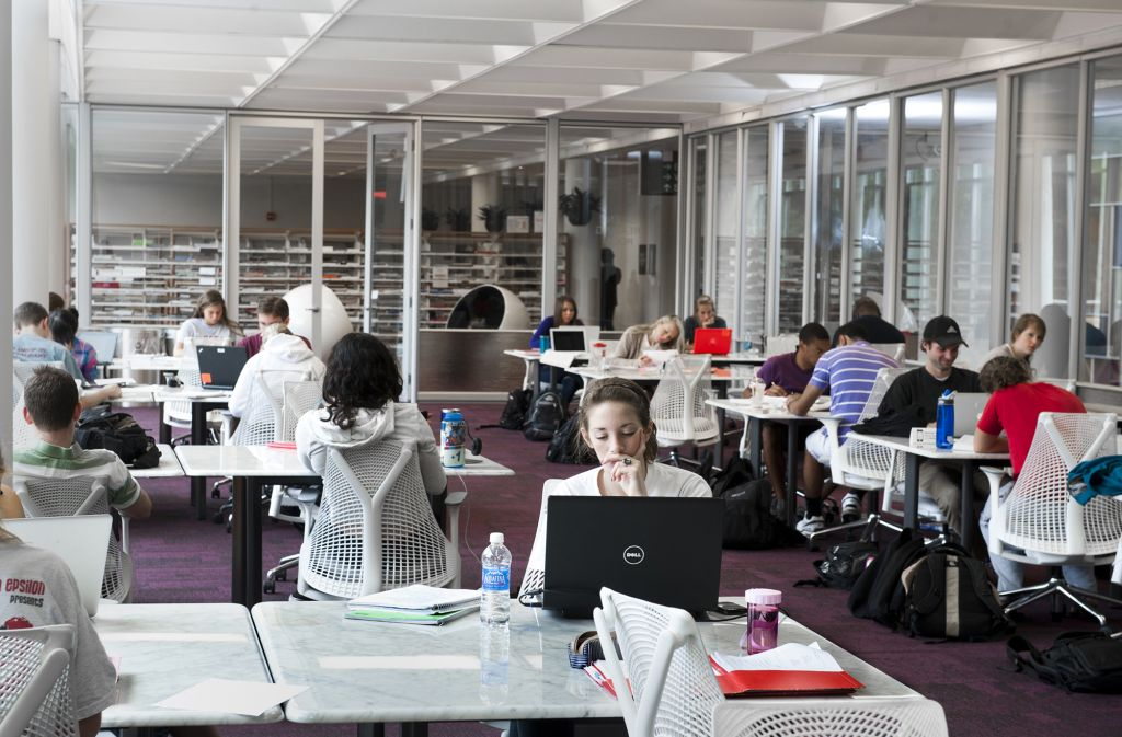 Students working at tables in Hill Library's silent reading room.