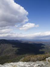 This is the shadow of a cloud passing over Linville Gorge as seen from Table Rock. Table Rock is located near Morganton, North Carolina.