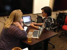 NCSU librarian Jennifer Garrett works with a graduate student.