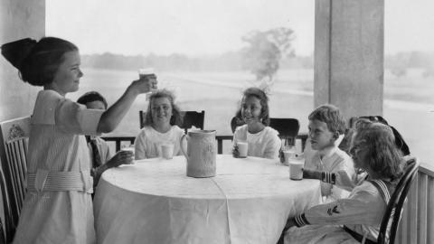 Six children drinking milk, ca. 1920.