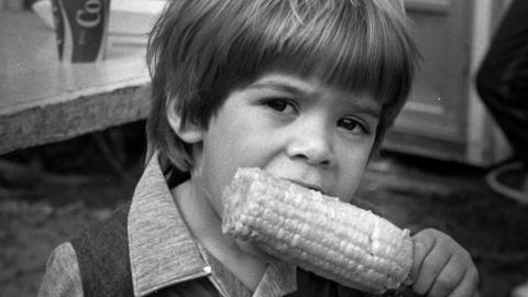 Boy eating corn on the cob at the NC State Fair, ca. 1979