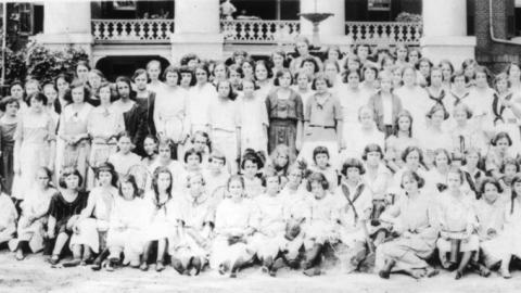 """NC 4-H Short Course, 1917.  Extension's home demonstration program taught girls and women how to cook """"sugarless"""" during the war."""