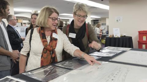 Friends of the Library members explore drawings from the Matthew Nowicki Papers at a recent open house event in Special Collections.