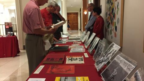 Alumni browse materials on display.