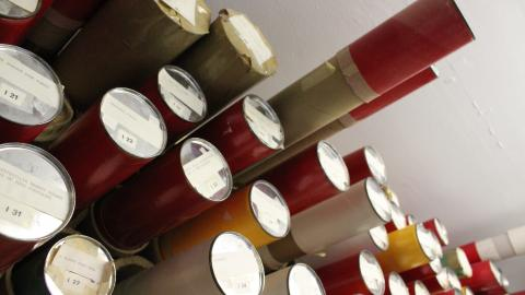 A sea of tubes containing architectural drawings awaits pickup by Special Collections staff.