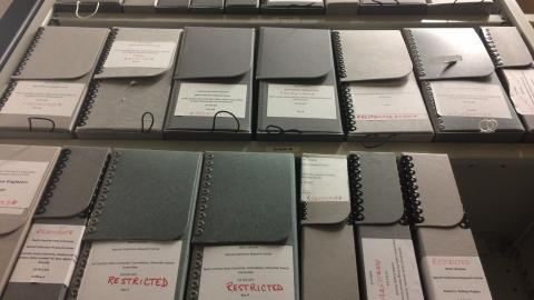 Shelves of restricted boxes from University Archives
