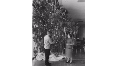 Decorating the Christmas tree at the College Union, 1955