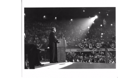 Candidate John F. Kennedy addressing an estimated crowd of 8,000 at Reynolds Coliseum, 1960.