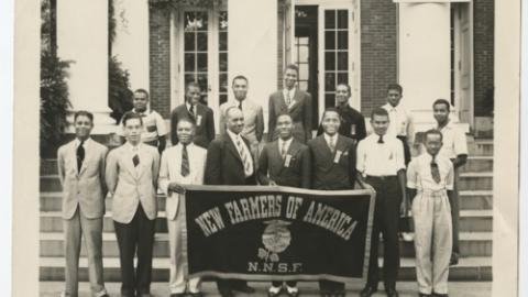 A Photograph of Unidentified NFA Student Members Holding a NFA Banner