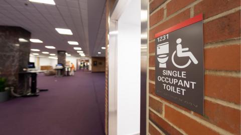 Bathroom placard for the single occupant toilet.