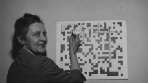Extension Agent Nita Orr with a Frozen Food Crossword Puzzle