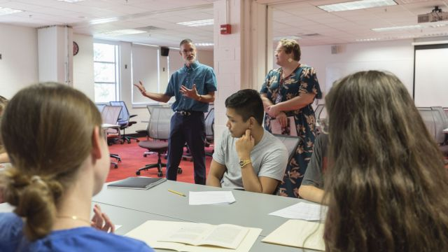 Professor John Murillo meets with his class at the Libraries