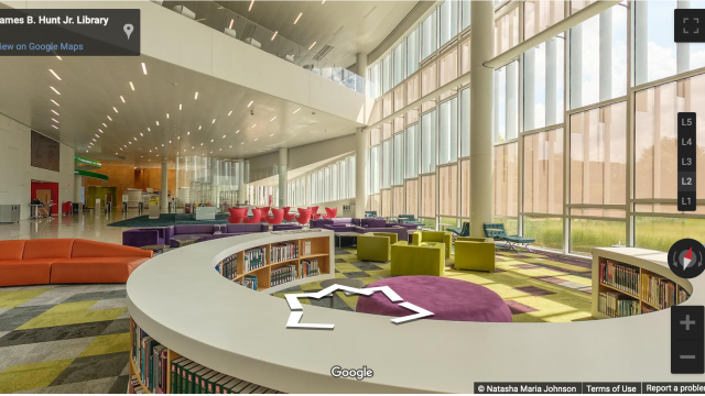 Screen capture of 360° tour, with colorful chairs and bookshelves