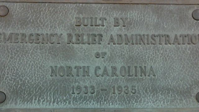 Plaque from NC State's Riddick Stadium (now demolished).  The stadium was at the site now occupied by SAS Hall and the adjacent parking lot.  The stadium stands and field house were constructed with New Deal funding.  From UA 020, Oversize Box 115.