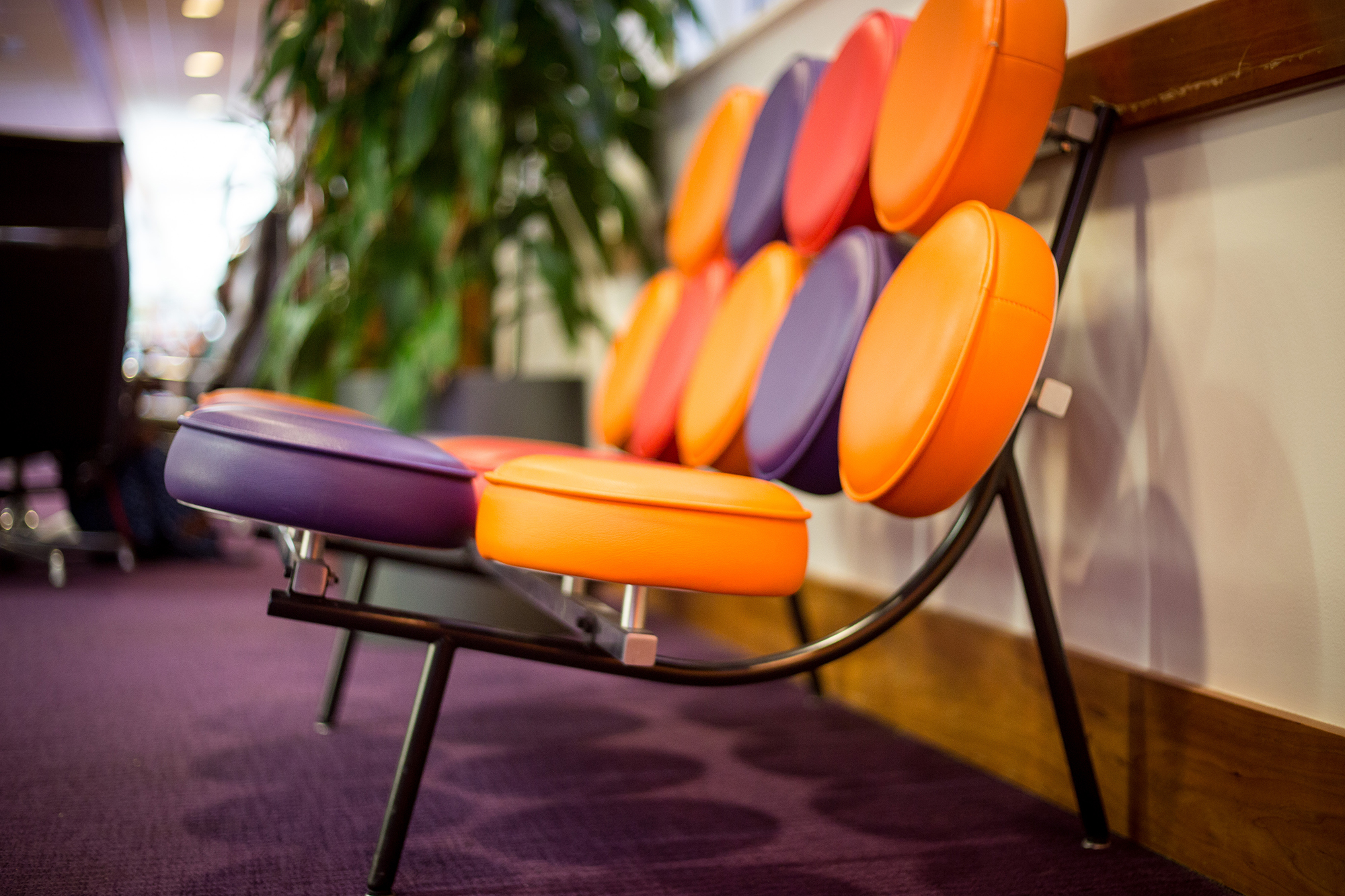 A purple and orange bench in the Learning Commons at DH Hill