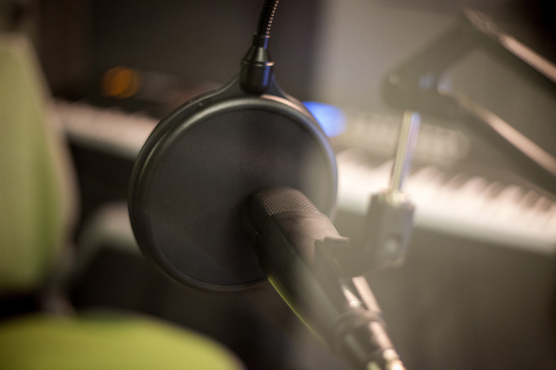 A microphone and attached pop filter in a music booth at DH Hill