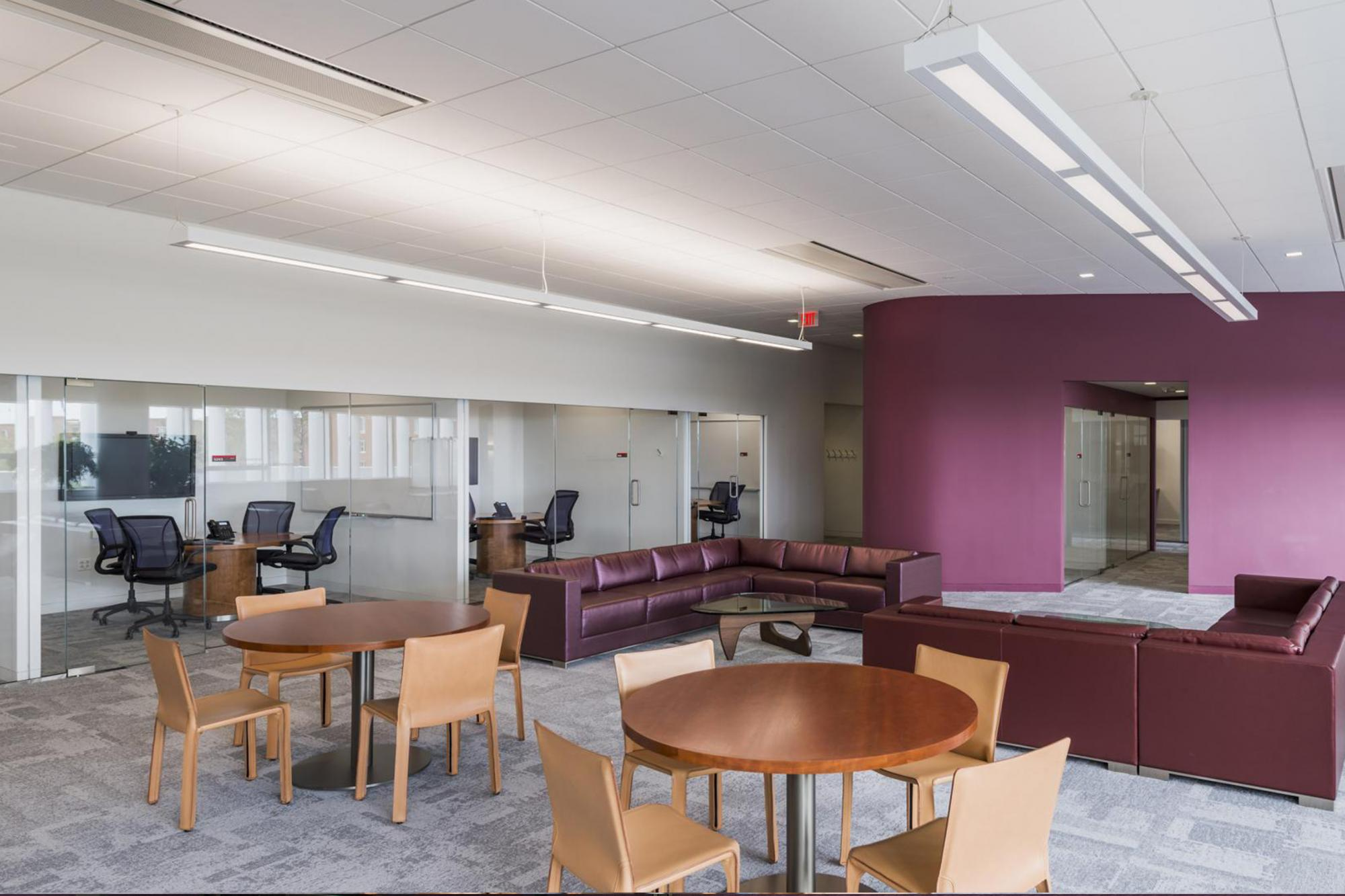 Couches, tables, and glass walled study rooms in Hunt's Faculty Research Commons
