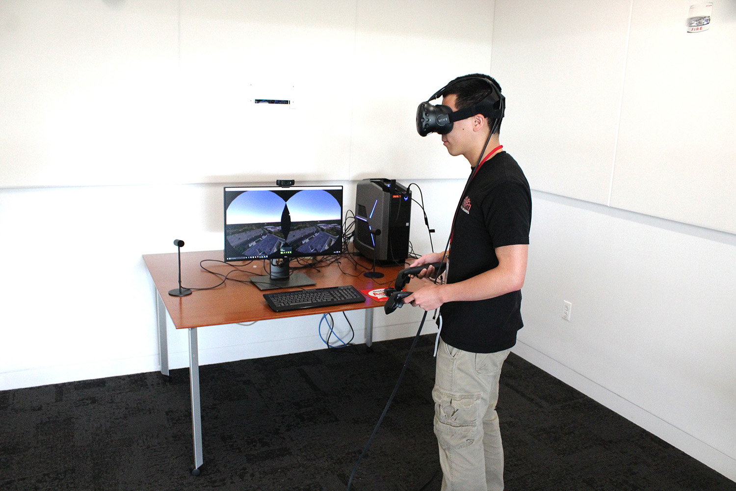 A student wearing a virtual reality headset in the VR Usability Lab at DH Hill